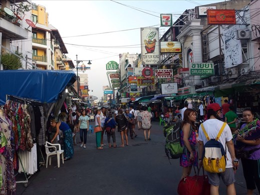 Khao San Road, Bangkok. It's referred to as the backpackers ghetto. Fun place to walk around and have a couple of beers.