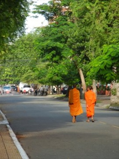 Early morning monks walking the streets of Phnom Penh
