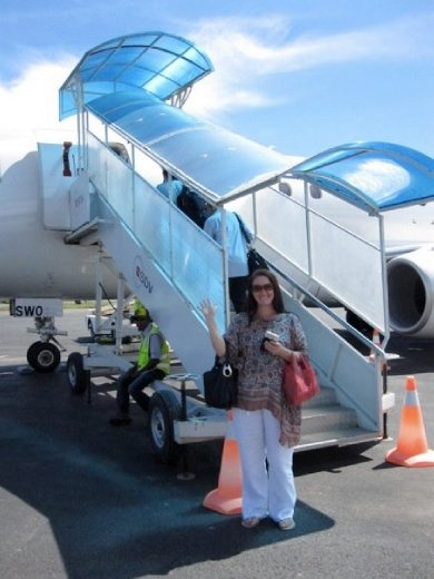 I wave farewell to Dili.