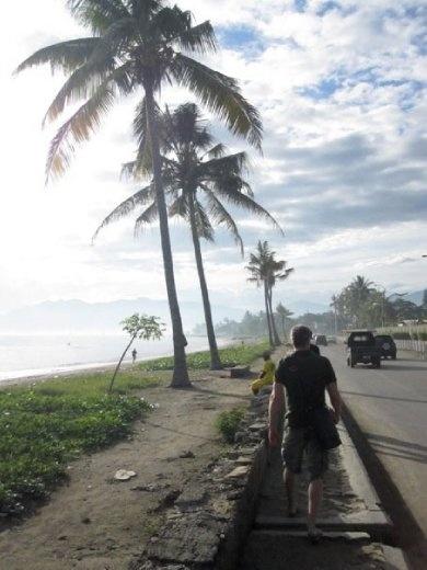 Whitey walking along Beach Road to our breakfast spot.