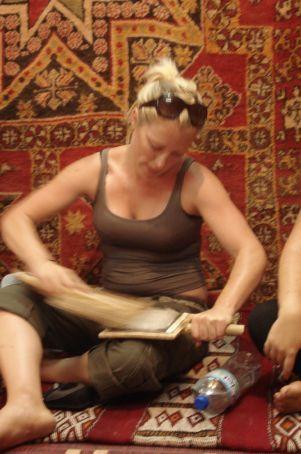 Me brushing wool in Morocco