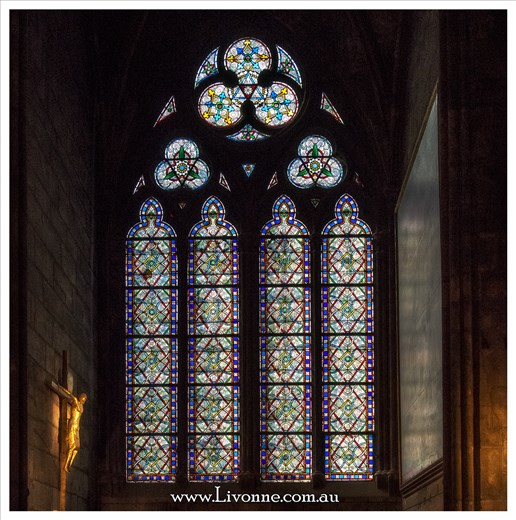 A stained glass window inside Notre Dame Cathedral