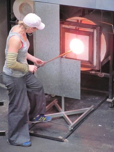 Kate working in the furnace at the glass studio, Wanganui