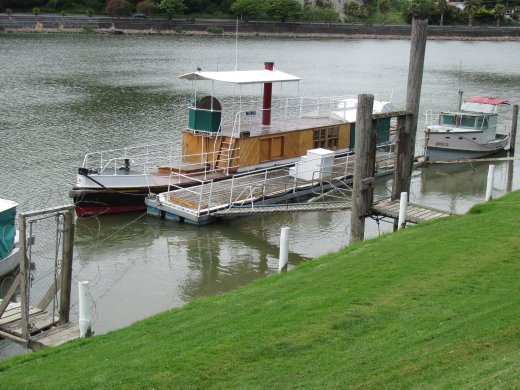 Ferry tied up at the wharf in The Wanganui River