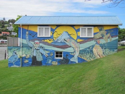 Fishy mural on building at the Wanganui River's edge