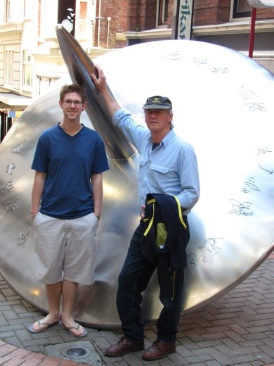 Andre and Greg trying to hide a large shiney sculpture in one of the back streets of Wellington.
