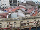 Red rooves of the historic Sze Ya Temple, snuck in behind the derelect building infront. It's having a major re-build. Seen from the guesthouse rooftop: by locomocean, Views[134]