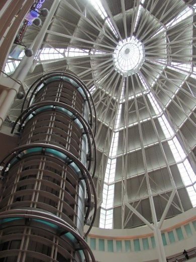 Inside the Petronas Towers Mall, looking up at the ceiling inside - the lift is to the left.