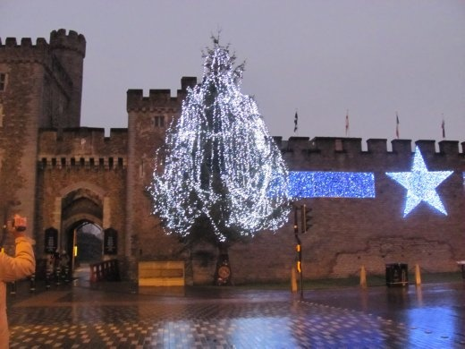 Christmas lights adorn the outside of the castle walls - it's getting dark fast as we leave.