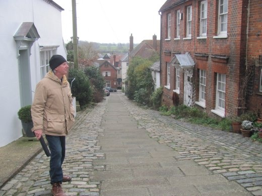 Greg, about to descend a gorgeous cobbled street in Arundel