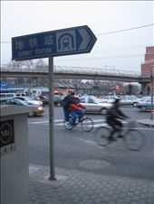 busy street corner in beijing ~ i was so glad to see this sign pointing to the subway....it was SO cold...!!!!: by lolo, Views[311]