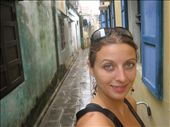 Just heading out, into the rain, in a stupid tank top. I HATED having no hoodie in Hoi An!  However, that said ~ the town was really cool to wander around in.  Here I am in an alley.  Cooler than it sounds...promise.: by lolo, Views[480]