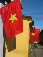 Colourful Vietnamese flags line the historic streets of Hoi An.: by lolo, Views[430]