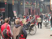 A street within the ancient city of Pingyao ~ the wall is possibly the last remaining intact city wall in all of China, and the warren-like maze of alleys and avenues inside has remained unchanged since the Ming Dynasty.  The place is absolutely swarming with Chinese tourists.: by lolo, Views[366]