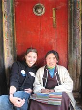 Sitting with a tibetan girl ~ I had sat down to have my photo taken with the red door, and she ran over to join me.  A much better photo than I'd had in mind...!: by lolo, Views[489]