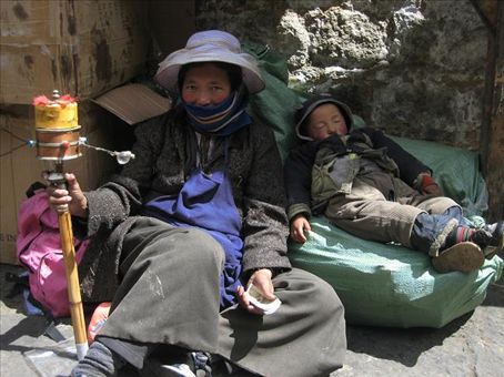 This woman and her baby were lying by the side of the path leading up to the Potala Palace ~just begging for cash and food.