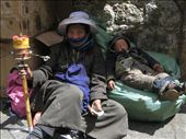 This woman and her baby were lying by the side of the path leading up to the Potala Palace ~just begging for cash and food.: by lolo, Views[325]