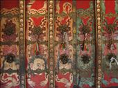 At Nechung Monastary, once the seat of the Oracle of Tibet.  The Dalai Lama would consult the oracle on all important issues of state.  He would go into a trance in order to give his advice...really spooky, according to eyewitnesses.  The Oracle fled to Dharamsala with the Dalai Lama ~ leaving behind such strange things as this door painted up with flayed human skins.: by lolo, Views[378]