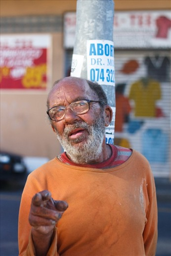 This bespectacled man is a regular in Salt River, a semi-residential area of bad repute that borders the industrial hub of Cape Town. I met him outside Fargo's trading - an outlet store frequented by Cape Town's muslim community for their huge range of spices and exotic food items. The abortion poster on the pole behind him is not an unusual sight.