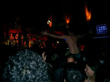Crazy man in kamakazi makeup dancing to the drumming.