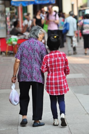 Grandma Is In Traditional Chinese Clothing Popularized By The Elderly In Hong Kong Whereas Granddaughter Is