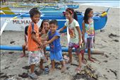 SWEET SMILES- While preparing for a team building activity at the shoreline I met this group of kids from the Fisherman's Village of Darapidap, Ilocos Sur, Philippines. They gave me their sweet smiles despite of the gloomy weather that afternoon.: by lybz, Views[116]