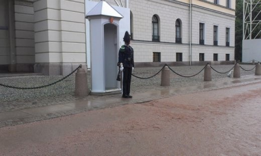 Poor guard who has to stand during the rain