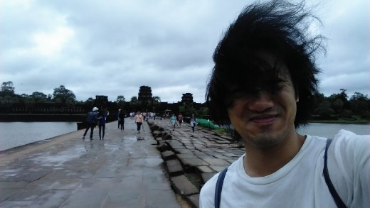 Posing in front of Angkor Wat