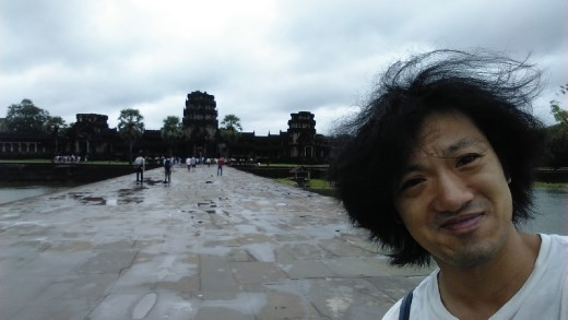 Posing in front of Angkor Wat