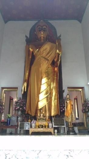 Giant standing Buddha opposite Phra Buddha Deva Patimakorn