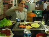 Rachel trying to master the Korean BBQ where the grill is on the table and they bring the raw vegetables and meats. Very good, again the secret is in the sauce.: by machel, Views[437]