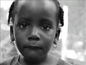 This little girl was fascinated with my camera and kept asking to have her picture taken.  Most children would smile but this is the face she made when I counted to three.  I can't get over the pain in her expression.: by madelinemckain, Views[213]