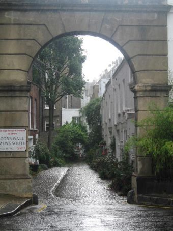 The big archway is called a mews and it is where the stables and carriages used to be stored.