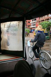 Take a moment, put yourself in my shoes and imagine yourself bumping along in a tuk tuk as you drive past that cyclist in a hat while it drizzles outside. Now imagine yourself wearing a straw hat, cycling though a wet morning while a tuk tuk zooms past. Just another morning in Cambodia.: by mahenbala, Views[563]