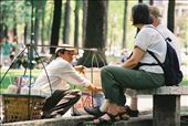 A vendor is serving cold coconut juice for a foreign couple. : by maiha, Views[138]