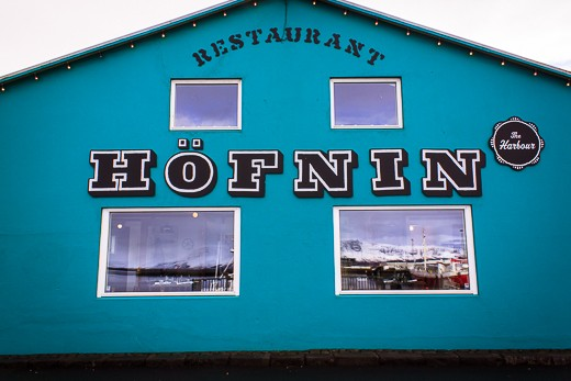 A colourful restaurant in Reykjavik harbour reflecting the Mt Esja