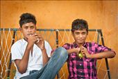 Two Maldivian teenagers relax in the street. Most island settlements feature small Islamic schools where children are taught in small classes.: by maldives, Views[503]