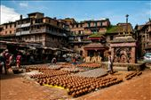 Pottery Square, Bhaktapur, Kathmandu.  These pottery squares are world renowned.   Here pottery is a family job, the place is common for all the villagers. so everyone in the village work together. their mundane life is part of their religious life too. so even in the common places we can see the temples and buddha statue everywhere in the village. : by manikandanav, Views[785]