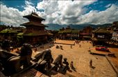 Dharbar Square, Bhaktapur, Kathmandu. This Monumental Darbar square was Malla kings darbar till 1769 BC. In one place we can see Monasteries, Pagodas, Palace and Temples together. Irrespective of its tourism developments the village has been kept without any modifications in its architecture beauty. what we see in the left corner is a restaurent in a old pagoda. Even in the 21st century the life happens  here in 17th century shadows.: by manikandanav, Views[567]