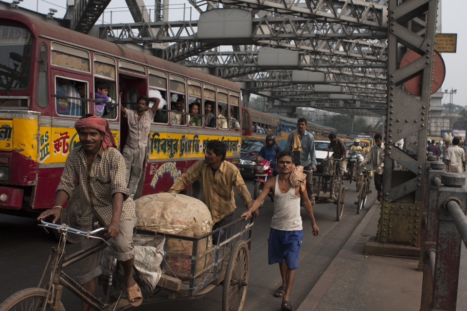 Traffic on the Howrah bridge,probably the busiest cantilever bridge in the world