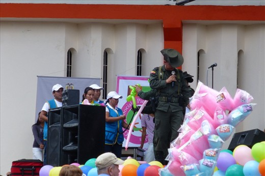 this soldier even sings and has a great voice amongst all those pink balloons.