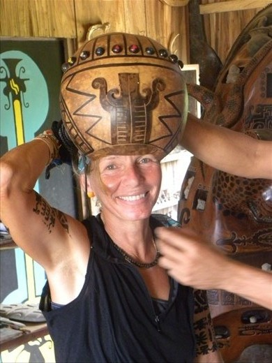 Wearing an Indigenous helmet at the museum in Jama