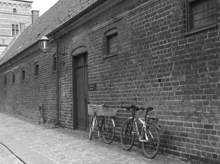 two bikes against wall