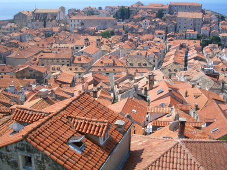 Note the colours of the rooftops. The yellow-orange tiles are original, while the terracotta ones were donated by UNESCO during the rebuilding of the town after it was partially destroyed during the war.