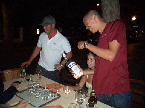 Sar from Australia (left in white) and Steve from Nevada dishing out the zambucca on Sunday night.