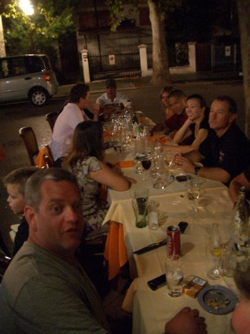Sunday night dinner in the burbs - Sar's chair, at the end, was literally sitting on the street.
