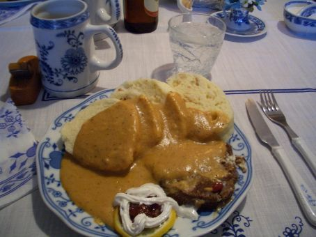 Svickova: Homemade knedliky (bread dumplings with bacon bits) w/ a cut of prime beef sirloin, thick creamy sauce enhanced w/ fresh cream and cranberry sauce. I think we've put on 5 kilos just by looking at it again! But absolutely delicious!