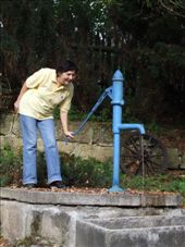 Jaka demonstrating how the local water supply works.  We nominate her for the 'Fittest Granny of the Year Award'! A true Aussie battler.: by maria_brett, Views[460]