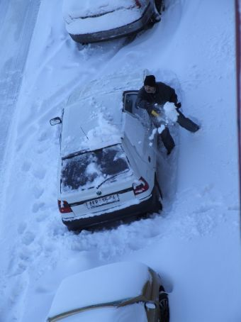 Part of the daily ritual, digging your car out of the snow.
