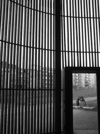 Looking out from the Chapel of Reconciliation, a memorial to the church that once stood here in the 'death strip' between East and West.  The original church was blown up in 1985 on orders from the East German government in its push to widen the death strip. Unfortunately this little community church stood in the way. The statue in the background was donated by Richard Branson.